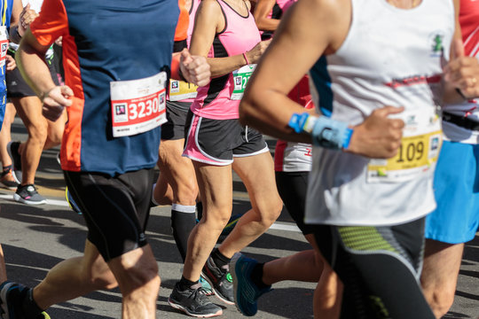 Runners during City Marathon Race Event in Summer Time