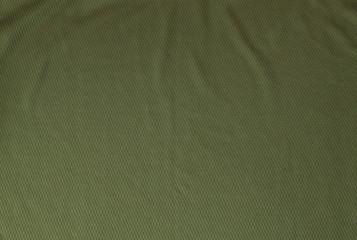 Dark green rough linen fabric texture close-up as background.