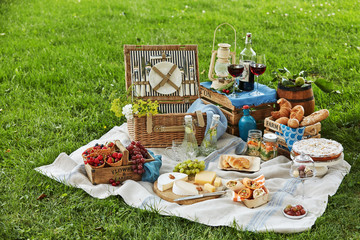 Gourmet picnic spread with wine and dessert
