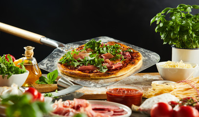 Freshly baked pizza on a metal paddle