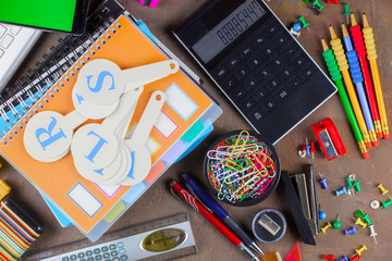 Back to school. Items for school classes in the composition on the table.