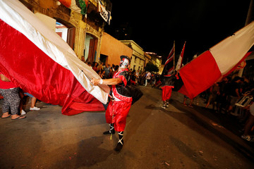 Members of a comparsa, an Uruguayan carnival group, participate in the Llamadas parade
