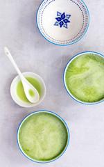 Brewed matcha green tea in Japanese tea cups.