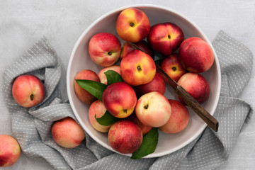 Overhead view of nectarines in bowl with knife
