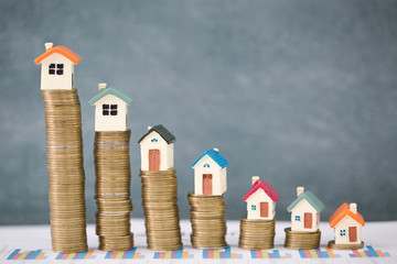 Mini house on stack of coins,Money and house, Mortgage concept, Real estate investment, Save money with stack coin.