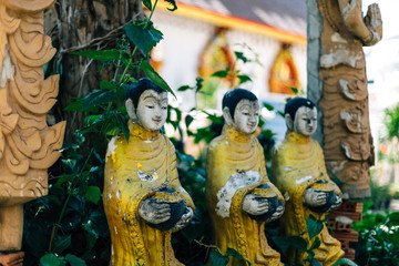 buddhist statues in forest, deep meditation in jungle, peace and nature