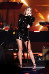 Miley Cyrus performs during a gala event honoring Dolly Parton as the MusiCares person of the year in Los Angeles