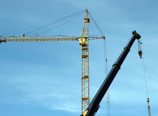 two crane tower on sky background