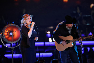 Trisha Yearwood and Garth Brooks perform during a gala event honoring Dolly Parton as the MusiCares person of the year in Los Angeles