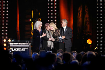 Dolly Parton reacts during a gala event honoring her as the MusiCares person of the year in Los Angeles