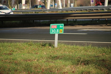 Distance sign at Motorway A16 at Zwijndrecht in the Netherlands