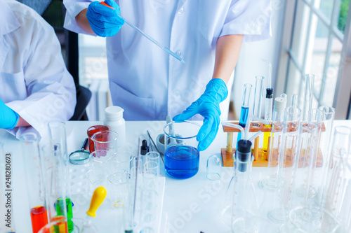 The scientist test new product by test tube in health sciences, life