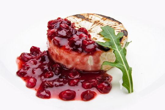 Fried Camembert cheese with cranberry sauce on white background