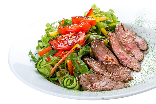 Salad with dried beef and tomatoes on white background