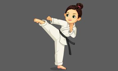 Cute little karate girl in karate pose 1