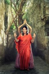 Two Caucasian woman perform Mehndi dance