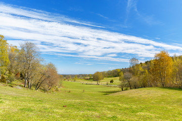 Rural landscape view in spring with leaf budding on the trees