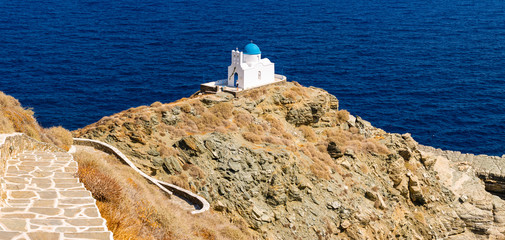 Small Chapel of Seven Martyrs with stunning views to the Aegean, village of Kastro, island of Sifnos, Cyclades, Greece