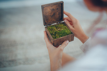 wooden wedding ring box and wedding bouqet