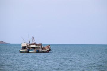 Two fishing boats landing on a beautiful sky