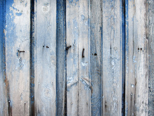 Wooden planks with blue flaked paint remains