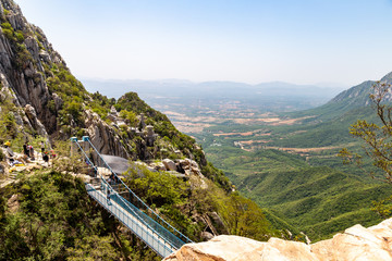 Suspended bridge and Sanhuang Basilica on the top of Songshan Mountain, Dengfeng, China. Songshan is the tallest of the 5 sacred mountains of China dedicated to Taoism, near the famous Shaolin temple