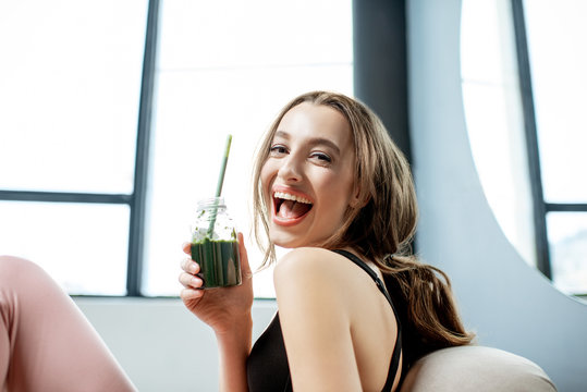 Sports woman with healthy food at home