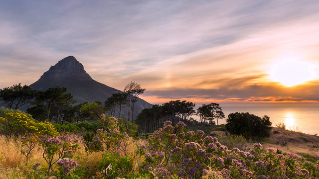 Beautiful sunset over the ocean and Lion's head mountain view from Signal hill in Cape Town