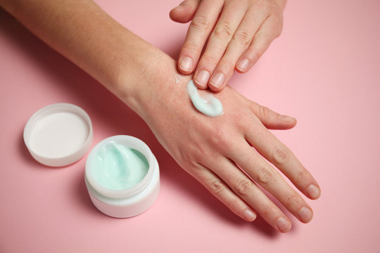 Frostbite of hands in cold. Red irritation on skin of hands. Moisturizing Cream.