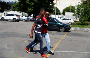 Relatives of Samuel Thomas Rosa, who was a victim of Flamengo soccer club's training center deadly fire, arrives at the Institute of Forensic Science, in Rio de Janeiro