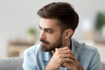Thoughtful concerned man thinking about problem solution lost in thoughts Wall mural