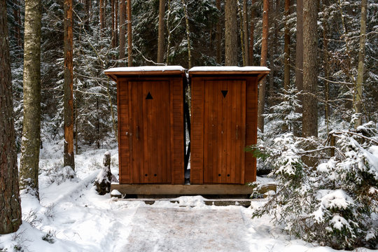 two rural Outback wooden Toilets in winter park