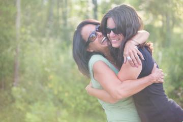 Joyful Mother and Daughter Hugging