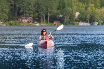 Happy Smilig Middle Age Woman kayaking in a Vacation setting