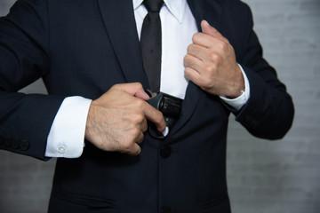 businessman with gun on gray background