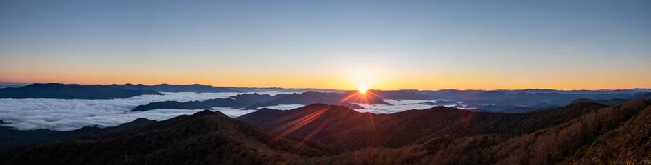 Foggy morning sunrise over unicoi mountains in North Carolina