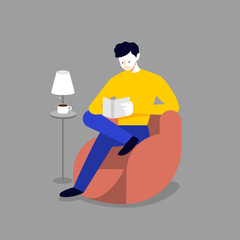 Man relax on sofa and reading book