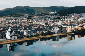 view of Kisogawa river and Inuyama cityscape in japan. Midday and clear sky. in Autumn Season.