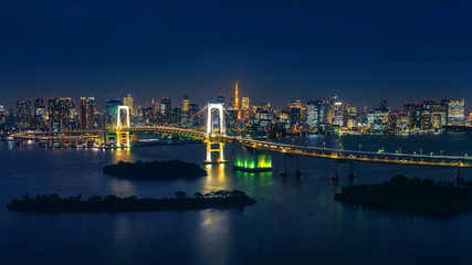 Fototapete - Panorama of tokyo cityscape and rainbow bridge at night.