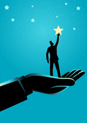 Giant hand helping a businessman to reach out for the stars