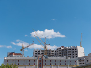 Construction site with many cranes against the sky
