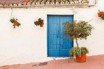 Blue Door in a Sloping Street in Estepona Spain