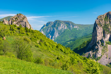 beautiful landscape of romania mountains. huge cliffs of canyon. wonderful nature scenery. sunny weather in springtime
