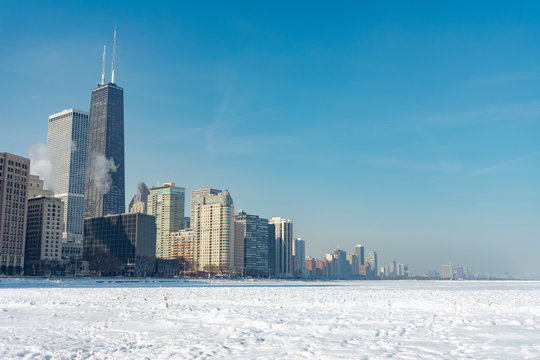 Chicago Skyline seen from Ohio Street Beach with Lake Michigan covered in Snow and Ice after a Polar Vortex