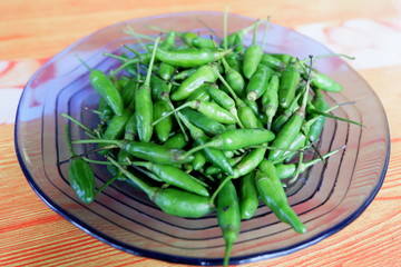 Fresh green chili on a plate for cooking ingredients