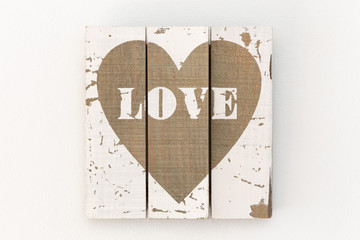 Wall with picture of white wooden boards and painted brown heart