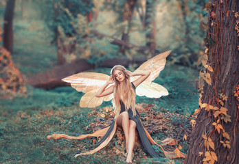 charming fairy woke up in forest, sweetly smacks after sleeping Wall mural