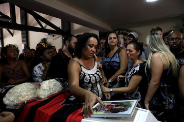 Marilia, mother of soccer player Vinicius de Barros Silva Freitas reacts during his funeral service after a deadly fire at Flamengo soccer club's training center, in Volta Redonda