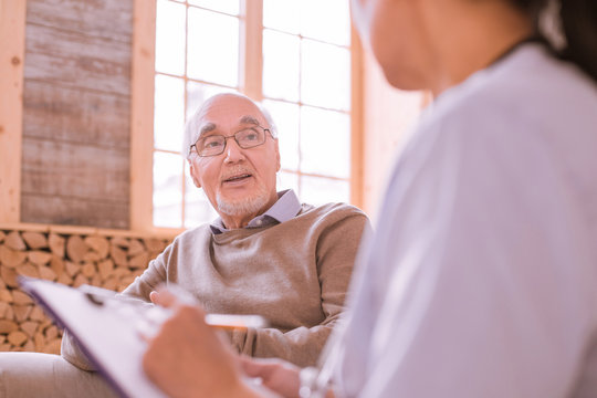 Delighted mature male person keeping smile on his face