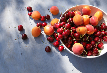 cherries and apricots in a bowl